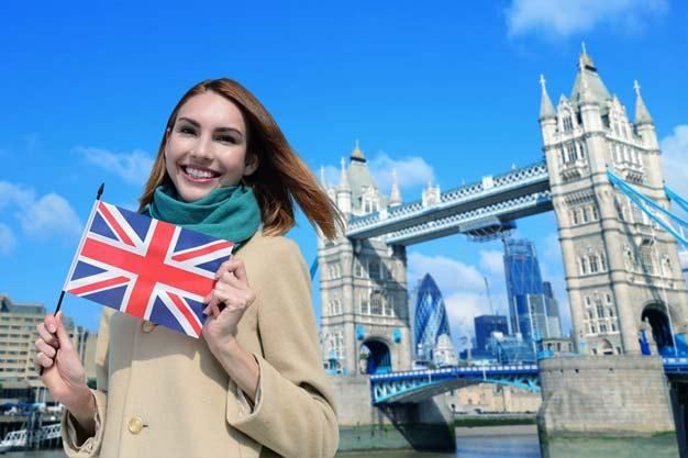 Thames International girl near to London bridge express her idea Why Should You Study in United Kingdom