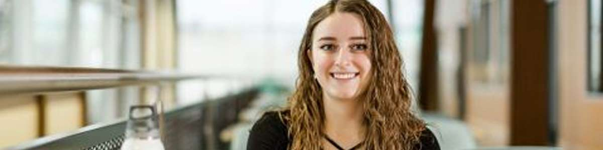 This British college girl represents for Scholarships for UK Studies Header